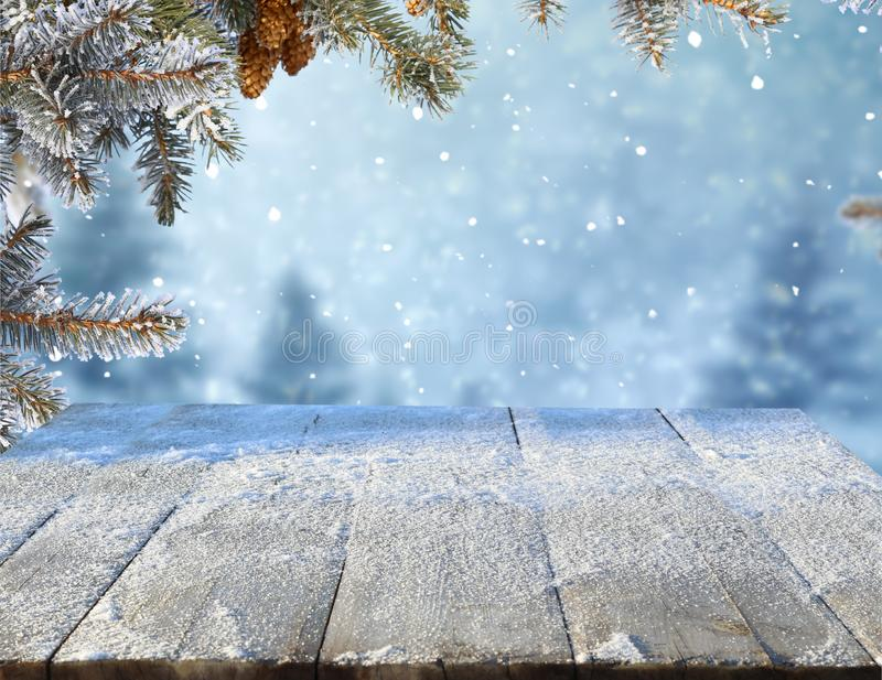 Christmas and new year greeting background with table .Winter landscape with fir tree. Merry christmas and happy new year greeting background with table .Winter royalty free stock photo