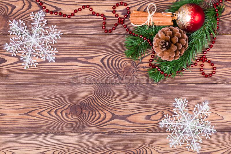 Christmas and New Year holiday background. Christmas decor on a wooden table. Top view, blank space stock image