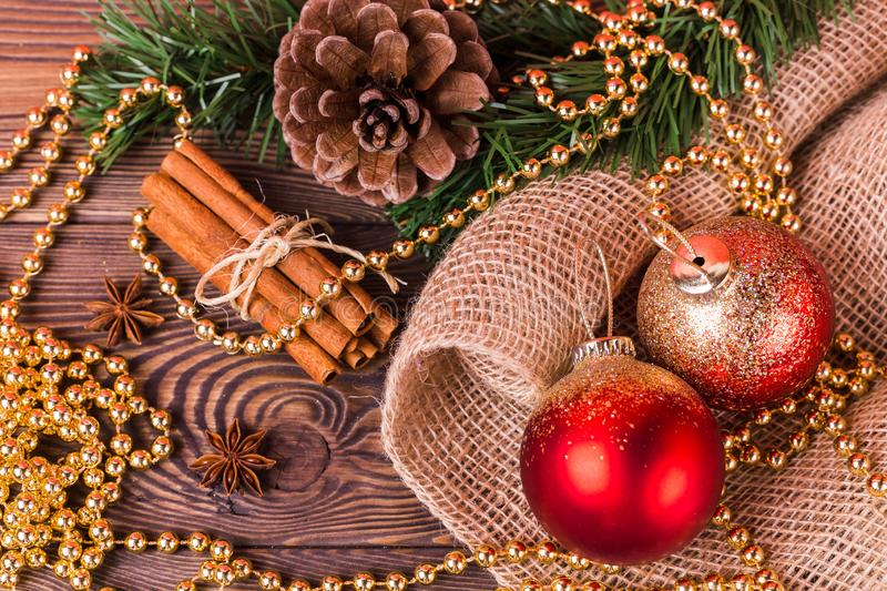 Christmas and New Year holiday background. Christmas decor on a wooden table. Top view, blank space royalty free stock photo