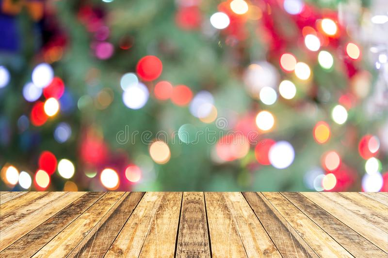 Christmas and new year holiday background with empty wooden deck. Table over festive bokeh. Ready for product montage stock image