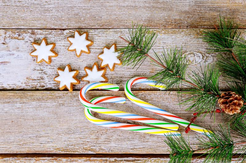Christmas New Year holiday background. gingerbread cookies and fir branch tree table. stock photos