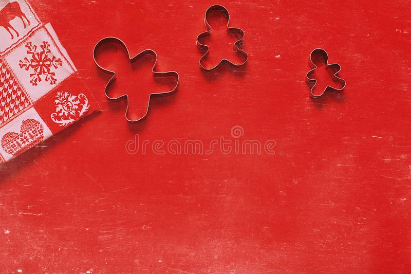 Christmas, New Year holiday background, texture, wallpaper.Cookie cutters on red background stock photo