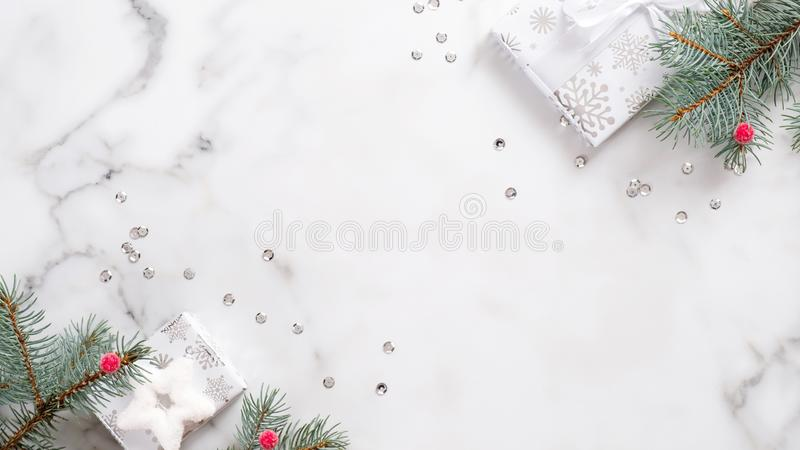 Christmas and New Year holiday banner. Christmas greeting card. Xmas white ribbon gifts on marble background top view. Flat lay royalty free stock images