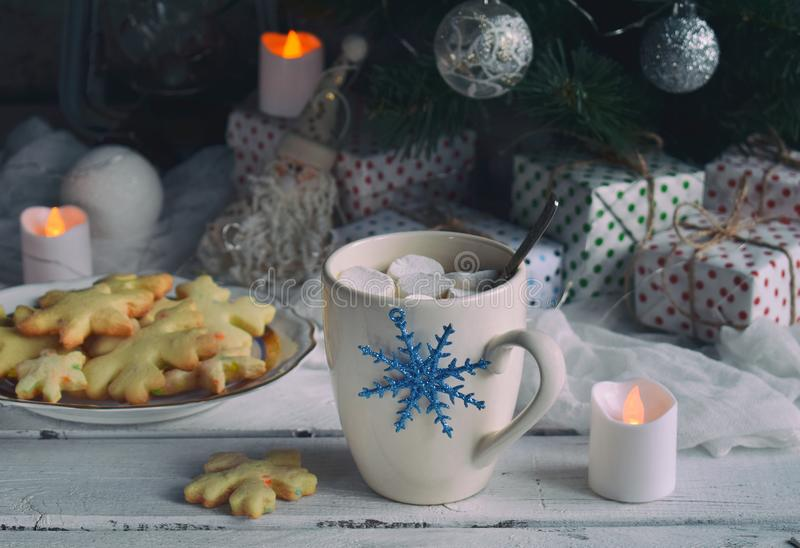 Christmas and new year holiday celebration concept background. Cup of cocoa with marshmallow, homemade chocolate cookie and peanut royalty free stock images