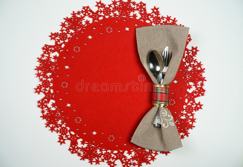 Christmas And New Year Holiday Table Place Setting. Top view, red woolen background. Winter holidays concept royalty free stock images