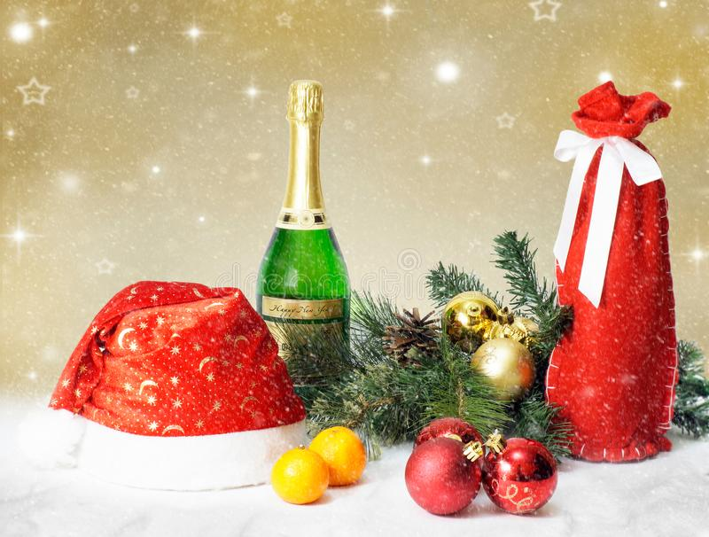 Christmas and new year holiday table setting with champagne and hat of santa claus. Celebration. stock photos