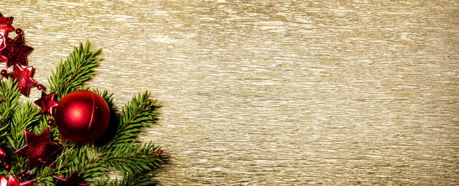 Christmas and new year luxury golden background design. Holiday xmas decoration and pine tree on gold glitter texture royalty free stock photos