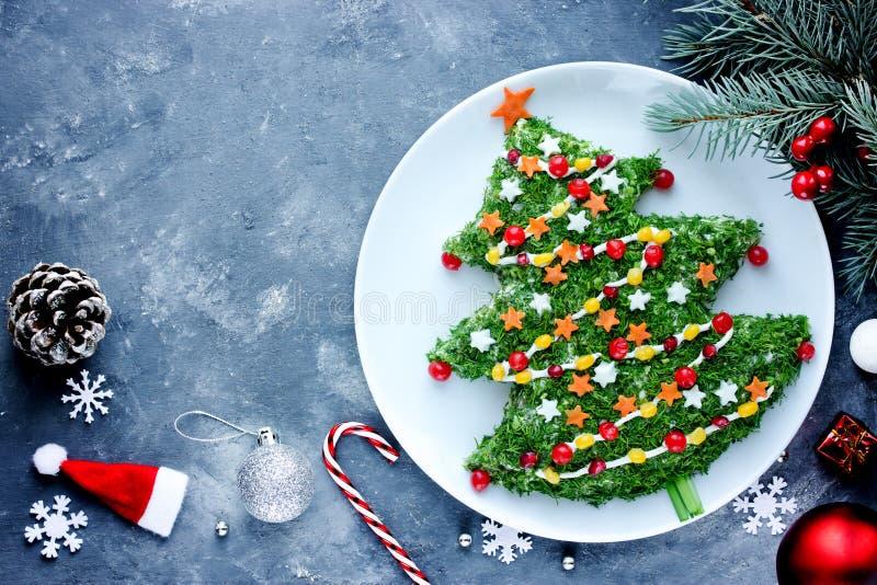 Christmas new year meal idea - creative appetizer salad like a christmas tree stock photos