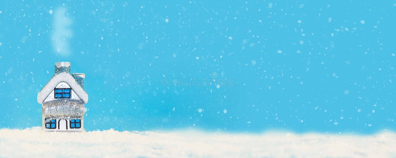 Christmas and New Year minimalism banner.Toy house in the snow on a blue background vector illustration
