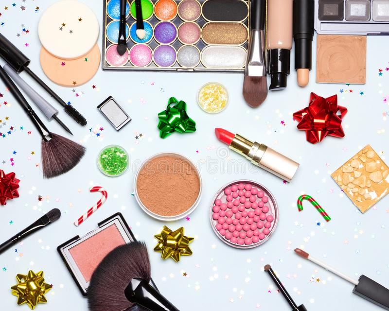 Christmas and New Year party bright glistening makeup flat lay stock images