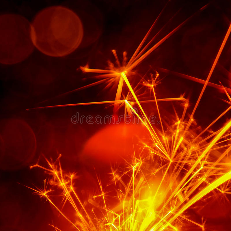 Christmas and New Year party sparkler with abstract circular bokeh background royalty free stock image