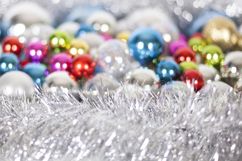 Christmas and New Year pattern, ornament of bright multi-colored glass decorative balls and tinsel, lights and sparkles, closeup stock image