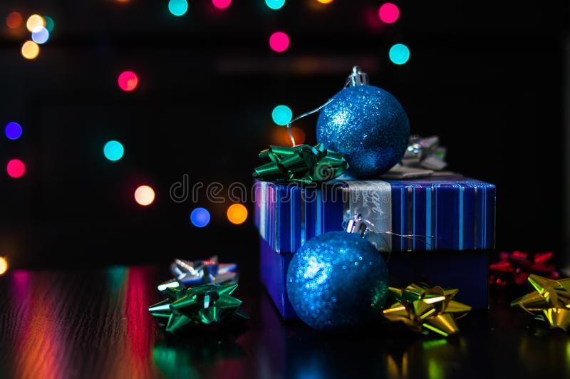 Christmas New Year present gift box with decoration on the table royalty free stock photos
