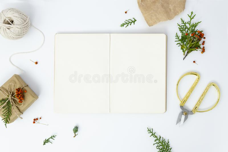 Christmas New Year presents frame on white background. Opened craft paper notebook mockup with copy space.  royalty free stock photo