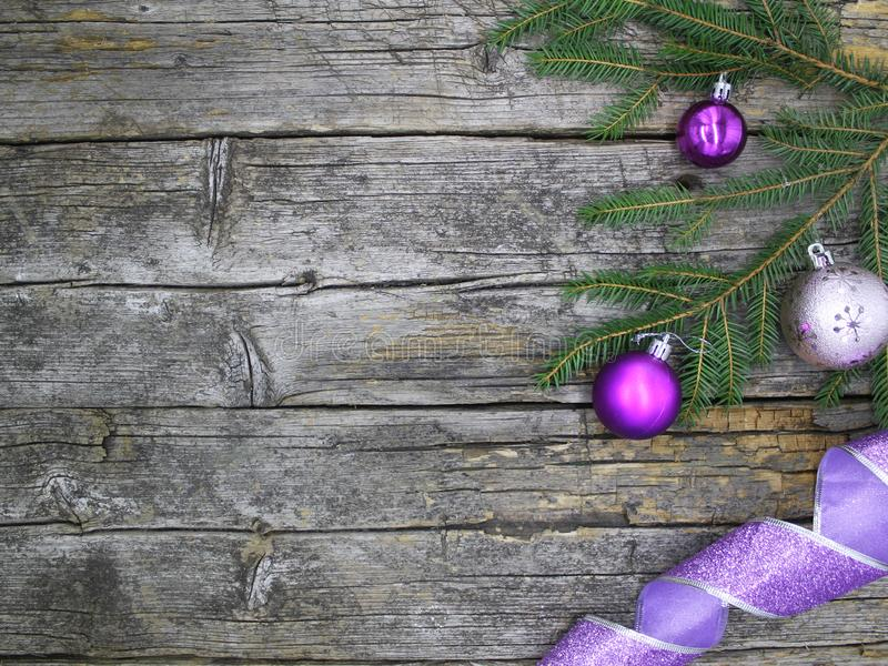 Christmas and New Year purple decorations on an old wooden background. View from above. Winter holidays concept, greeting card or background stock photography