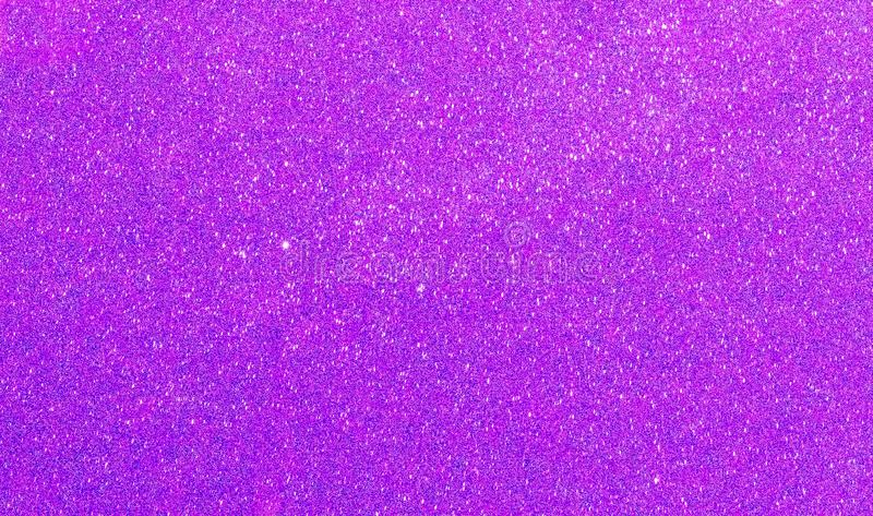 Christmas New Year Purple Glitter background. Holiday abstract texture fabric. Element, flash. royalty free stock photo