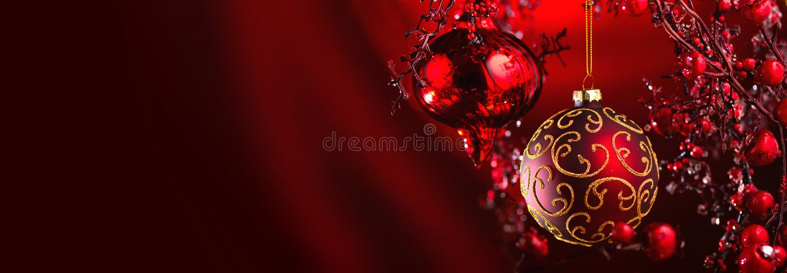 Christmas and New Year Red Decoration. Abstract Blurred Bokeh Holiday Background with beautiful baubles and Blinking Garland. Christmas Tree Lights Twinkling royalty free stock photos