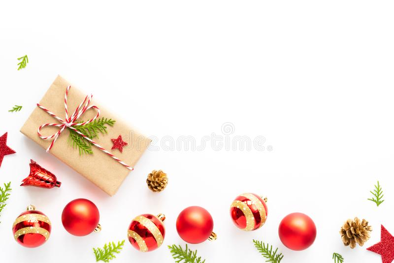 Top view of Gift box, pine cones, red star and bell on a wooden white background. stock image
