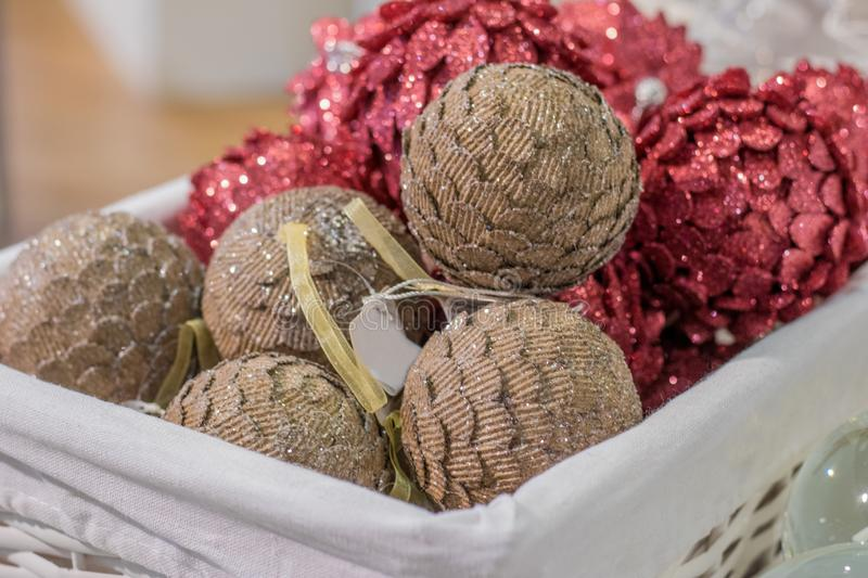 Christmas and New Year`s decorations in the form of balls in basket stock photo