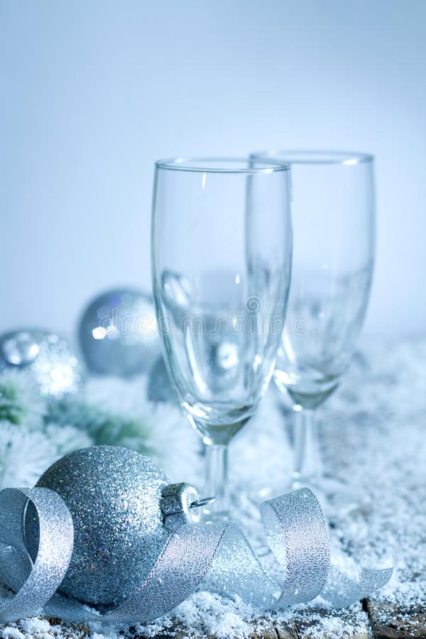 Christmas New Year`s eve dinner background concept with empty glasses of champagne stock photo