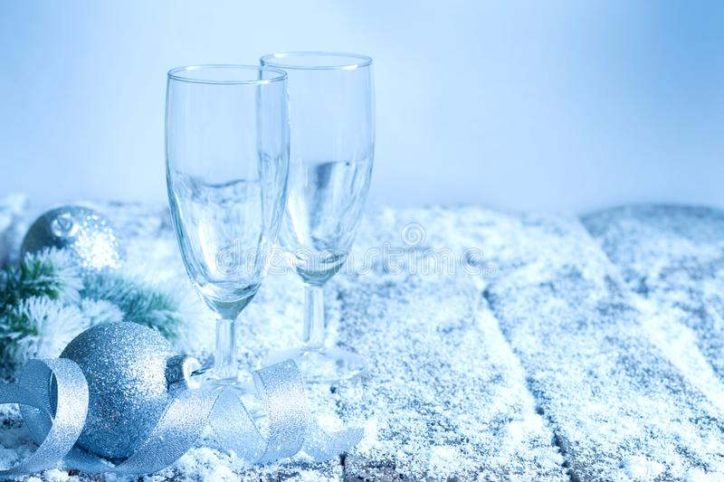 Christmas New Year`s eve dinner background concept with empty glasses of champagne royalty free stock image
