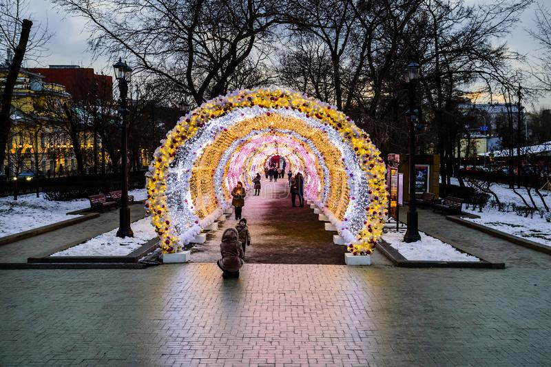Christmas and New Year`s festive light installation in the form of a tunnel. Moscow, Russia. stock photos