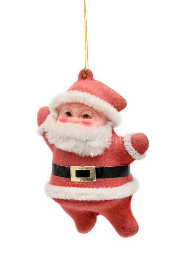 Christmas and New Year`s Santa Claus on white background. Red.Retro toy stock image
