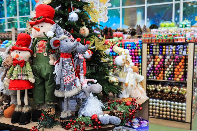 Christmas and New Year`s toys. Toy rat 2020 character and funny dolls in hats on toy store. Christmas and New Year`s toys in the store. Toy rat 2020 character royalty free stock photo