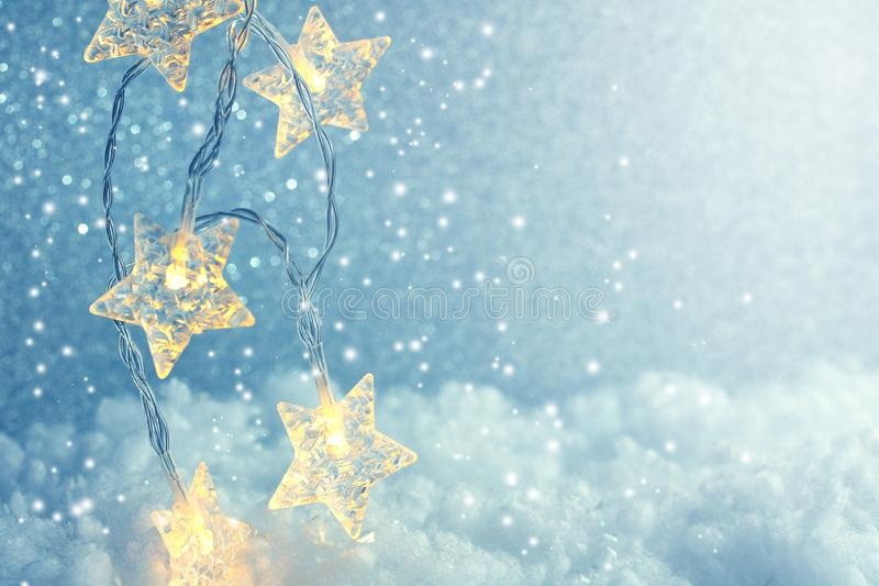 Christmas and New Year shiny background, garland star lights stock photo