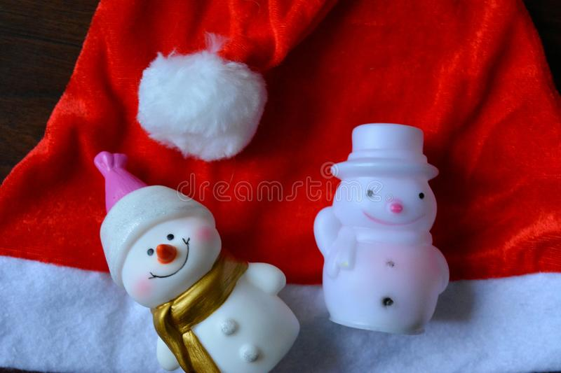 Christmas and New year snowmans decor and red hat background. Christmas and New year decor snowmans red hat background stock photography