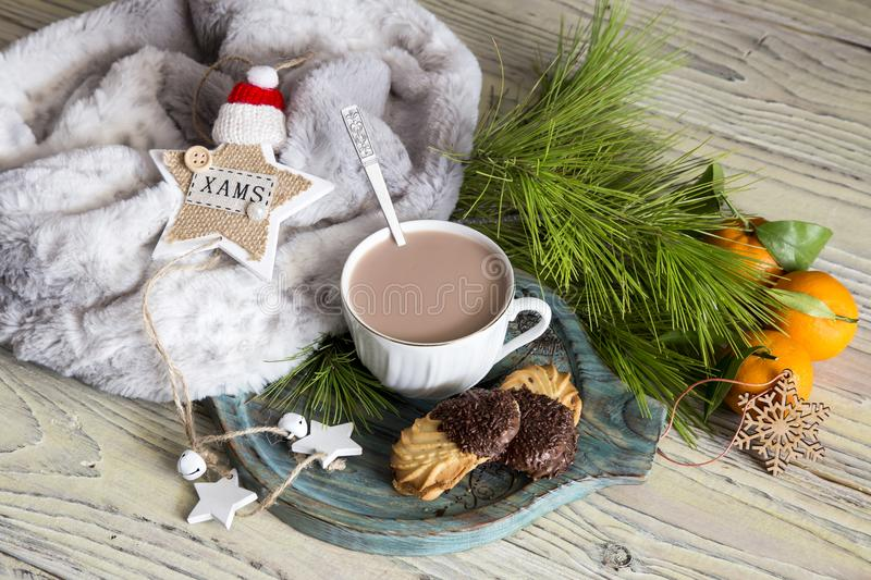 Christmas still life. Cocoa, cookies and scarf on the table close-up. Christmas and New Year still life. Cocoa in a cup, cookies, scarf and Christmas toys on a royalty free stock photography