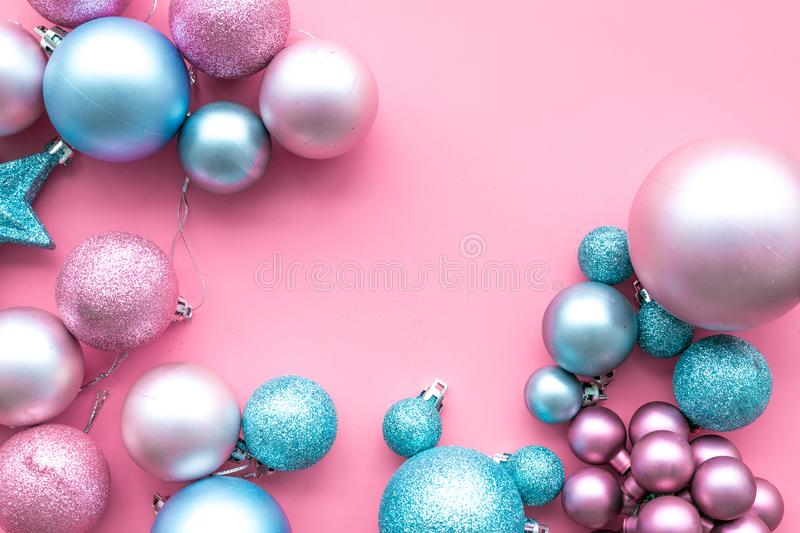 Christmas and New Year symbols. Toys for festive tree. Blue and pink balls and stars on pink background top view space stock images