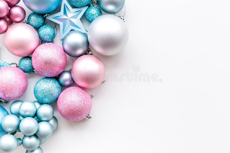 Christmas and New Year symbols. Toys for festive tree. Blue and pink balls and stars on white background top view copy royalty free stock photos