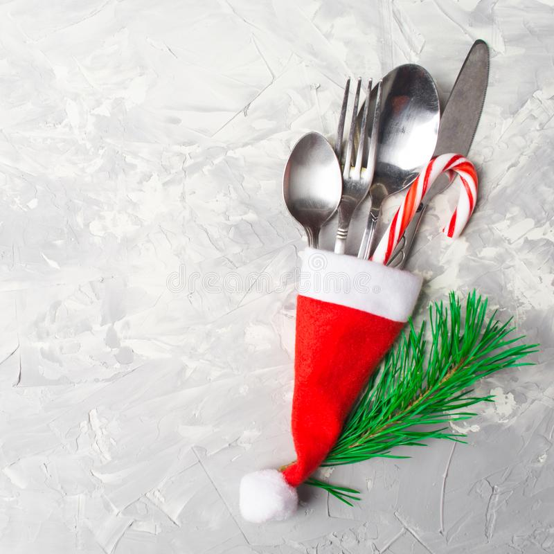 Christmas or New Year table decoration setting. With copy space, overhead view; square shot stock photo