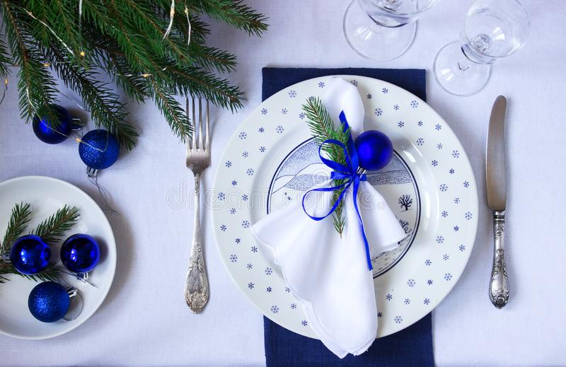 Christmas or New Year table decoration in white and blue colors. Selective focus royalty free stock images