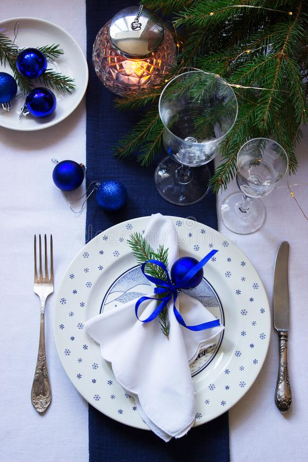 Christmas or New Year table decoration in white and blue colors. Selective focus stock photo