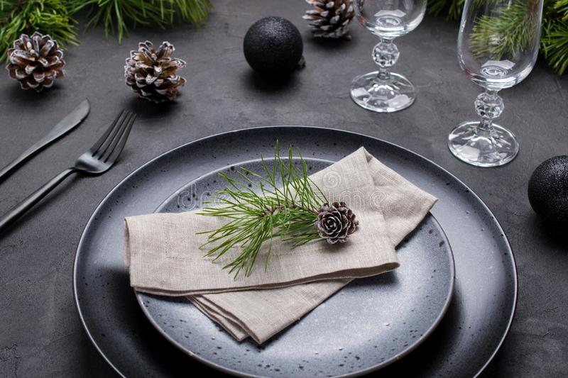 Christmas or New Year table setting. Place setting for Christmas Dinner. Holiday Decorations. stock photos