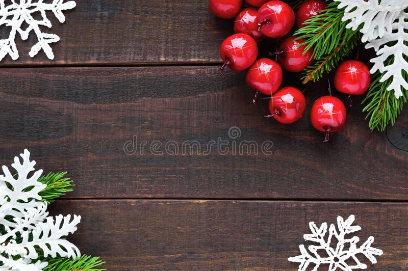 Christmas, New Year theme. Green spruce branches, ornamental berries, snowflakes royalty free stock images