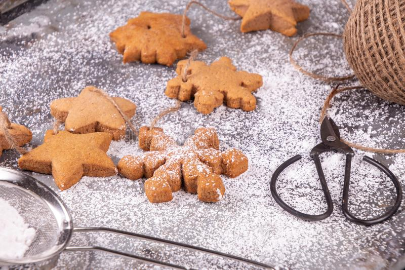 Christmas New Year traditional gingerbread cookies star and snowflake shape on rusty surfase with sugar powder. T stock photo