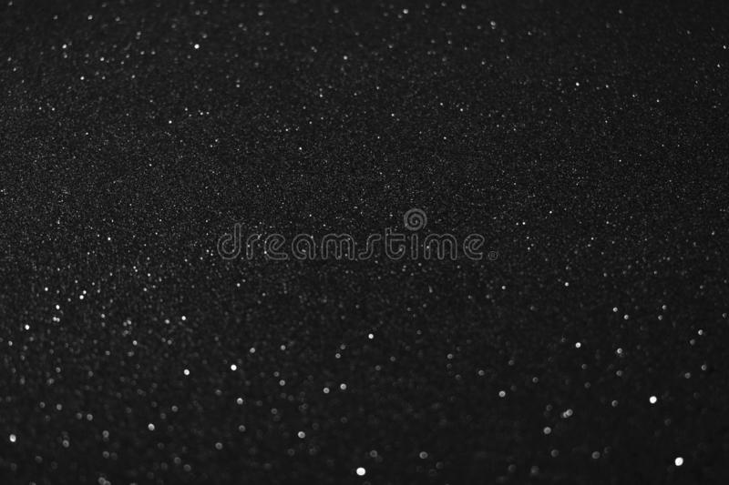 Christmas New Year Valentine Day black Glitter background. Holiday abstract texture fabric. Element, flash. stock image