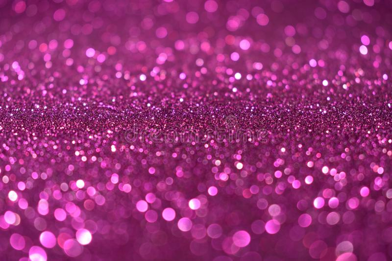 Christmas New Year Valentine Day violet pink Glitter background. Holiday abstract texture fabric. Element, flash. royalty free stock photos