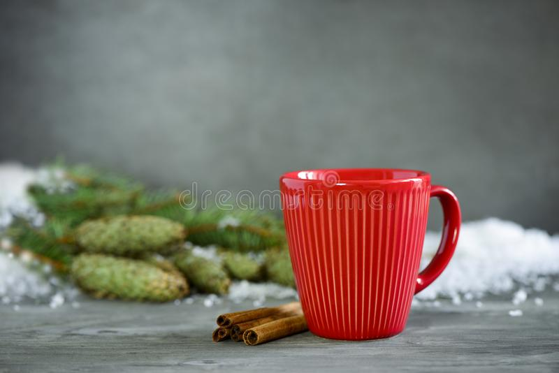 Christmas or New Year winter holidays hot drink in a red cup. Christmas or New Year winter holidays warming spicy drink in red cup stock photo