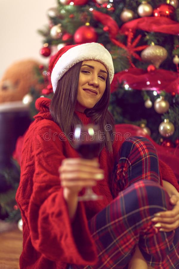 Christmas and New Year. Woman in santa`s hat is holding a galss wine stock photos