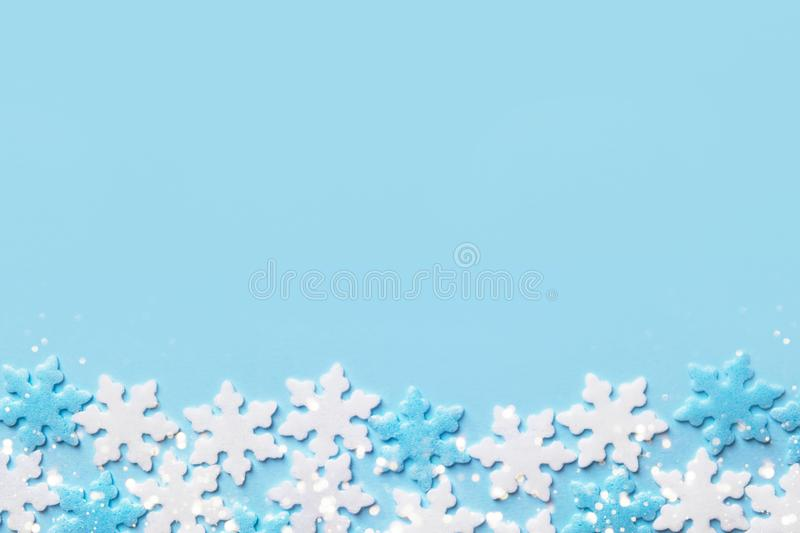 Christmas New Years background white blue snow flakes on cyan backdrop. Minimalist elegant style for holiday poster banner. With copy space stock photos
