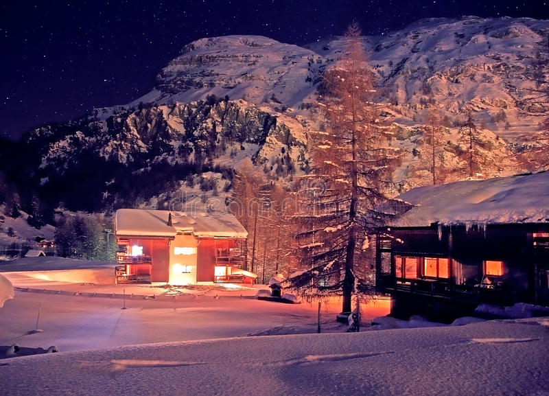 Download Christmas night in Alps stock image. Image of light, chalet - 11295383