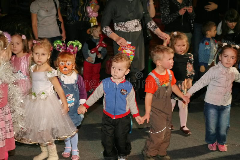 Christmas night. children at a children's party costume, new year's carnival. Concept of traditional world celebration, family holiday. New Year. Children's stock image