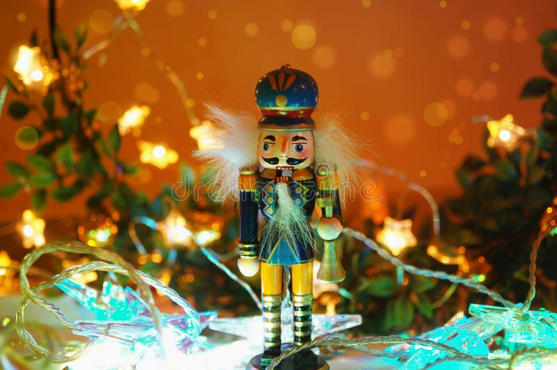 Christmas nutcracker toy soldier with christmas light background royalty free stock images