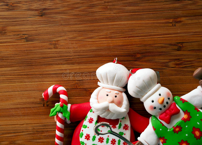 Christmas - old wooden background and funny chef Santa Claus. Spain stock photo