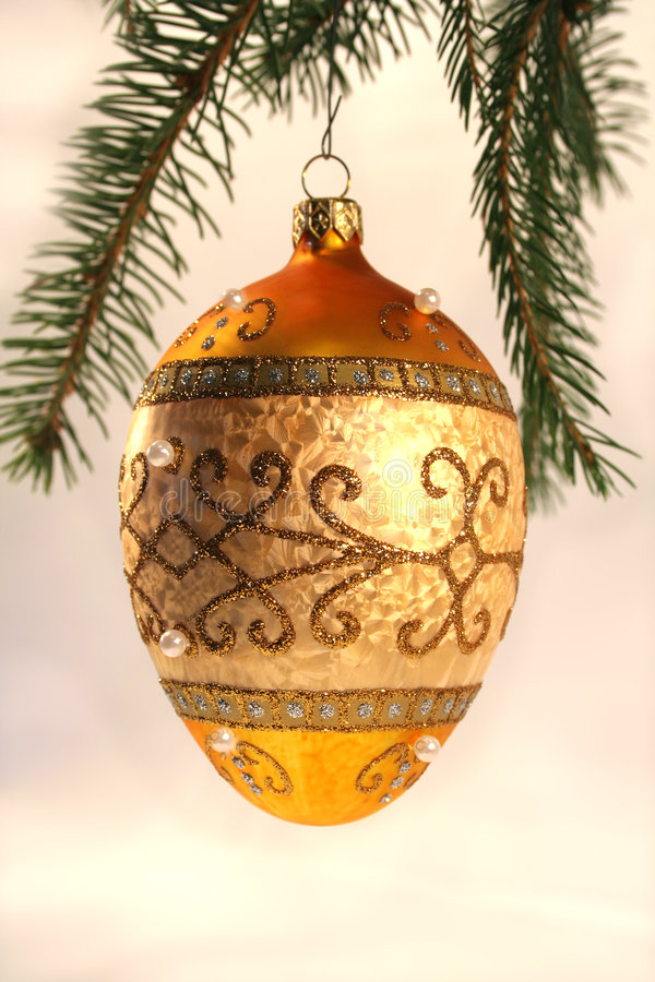 Christmas ornament. Hand-blown christmas ornament hanging from pine branch stock image