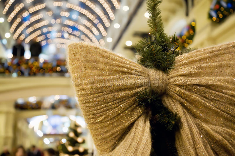 Christmas Ornament In Form Of Bow On Fir-tree Royalty Free Stock Photos
